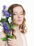 Beautiful teen girl with flowers Stock Photography
