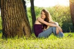Beautiful teen girl in forest smile Stock Photography