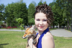 Beautiful teen girl  and fox Royalty Free Stock Image