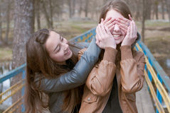 Beautiful teen girl friends playing on the bridge Royalty Free Stock Photos