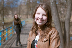 Beautiful teen girl friends smiling on the bridge Royalty Free Stock Photography