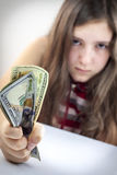 Beautiful teen girl grabs US dollars Stock Photos