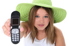 Beautiful Teen Girl Handing Cellphone To Camera Stock Photography
