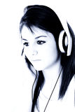 Beautiful Teen Girl With Headphones In Blue Tones royalty free stock images