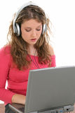 Beautiful Teen Girl with Headphones and Laptop Stock Image