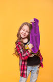 Beautiful teen girl with her birthday gift over yellow background Royalty Free Stock Photo