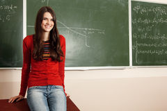 Beautiful teen girl high achiever in classroom near desk Stock Photography