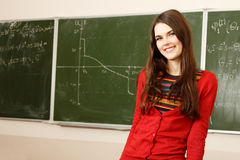 Beautiful teen girl high achiever in classroom over desk happy s Royalty Free Stock Photo
