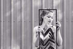 Beautiful teen girl holding broken glass in her hands. concept to overcome challenges in adolescence. Beautiful teen girl holding broken glass in her hands stock image