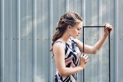 Beautiful teen girl holding broken glass in her hands. concept to overcome challenges in adolescence. Beautiful teen girl holding broken glass in her hands stock photos