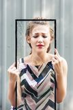 Beautiful teen girl holding broken glass in her hands. concept to stop violence against women. Beautiful teen girl holding broken glass in her hands. concept to royalty free stock photography