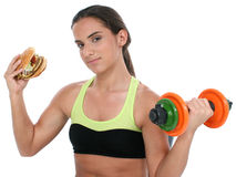 Beautiful Teen Girl Holding Colorful Weights And A Giant Cheeseburger Stock Photo