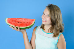 Beautiful teen girl holding in one hand a large piece of ripe wa Stock Image