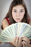Beautiful teen girl holding US dollars Stock Images