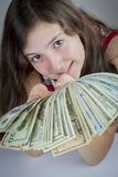 Beautiful teen girl holding US dollars Stock Photography