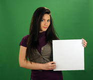 Beautiful Teen Girl Holds a White Card Royalty Free Stock Images