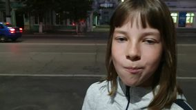 Beautiful teen girl inflating bubble of chewing gum. Moderm fashion girl. stock video footage