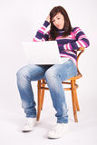 Beautiful teen girl with laptop Royalty Free Stock Image