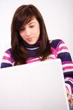 Beautiful teen girl with laptop Stock Image