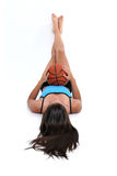 Beautiful Teen Girl Laying On Floor Holding Basket Ball Royalty Free Stock Image
