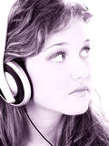 Beautiful Teen Girl Listening To Headphones In Grape Tones Stock Images