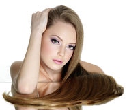 Beautiful teen girl with long straight hair royalty free stock image