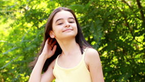 Beautiful teen girl looking at the camera in park Royalty Free Stock Photography