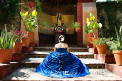 Beautiful teen girl. Lovely teen girl with a blue dress praying Royalty Free Stock Images
