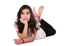 Beautiful teen girl lying on floor relaxing Stock Photography