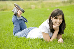 Beautiful teen girl lying on grass Stock Photography