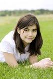 Beautiful teen girl lying on grass Royalty Free Stock Photo