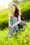 Beautiful teen girl  on meadow smile Royalty Free Stock Photography
