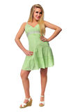Beautiful teen girl model. Wearing a green dress on a neutral background royalty free stock photo