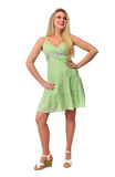 Beautiful teen girl model. Wearing a green dress on a neutral background stock image