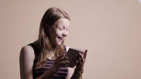 Beautiful teen girl opens a gift box. 4K UHD. Native video stock video footage