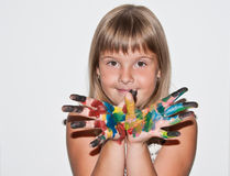 Beautiful teen girl with paited fingers. On her face Royalty Free Stock Photo