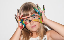 Beautiful teen girl with paited fingers. On her face Royalty Free Stock Photography