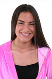 Beautiful Teen Girl in Pink. Casual portrait of a beautiful teen girl in braces and a pink jacket.  Shot against a white background Royalty Free Stock Photo