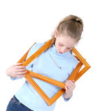 Beautiful Teen Girl Playing With Empty Picture Frames Over White stock photos