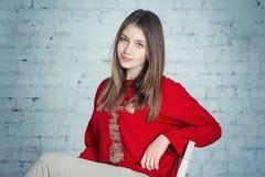 Beautiful teen girl. Portrait of beautiful teen girl sitting on a chair stock photos