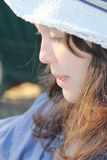Girl hat. Beautiful teen girl side view in hat Royalty Free Stock Photography
