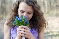 Beautiful teen girl smell Royalty Free Stock Images