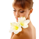 Beautiful teen girl smelling flower Royalty Free Stock Images