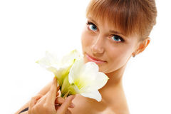 Beautiful teen girl smelling flower Stock Photos