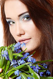 Beautiful teen girl with snowdrop flowers Stock Photos