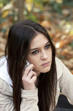 Beautiful teen girl talking on cell phone Stock Photo