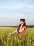 Beautiful Teen Girl Talking Mobile Phone Field. Beautiful Teen Girl Talking Mobile Phone Green Field Royalty Free Stock Image