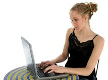 Beautiful Teen Girl Working on Laptop Royalty Free Stock Images