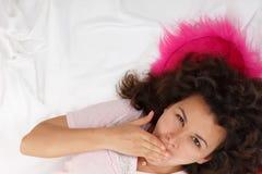 Beautiful teen girl yawns Stock Photo