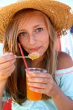 Beautiful teen with an iced drink  Royalty Free Stock Image
